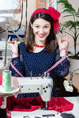Woman with sewing machine and measuring tape — Stock Photo