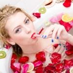 Woman licking ice cream wand  in bath — Stock Photo #44776289