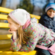 Girl and boy sitting on a bench — Stock Photo #44778389