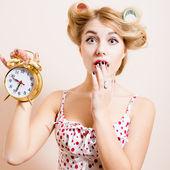 Surprised  woman  holding alarm clock — Stock Photo