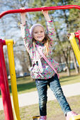 Beautiful cute girl riding a swing — Stock Photo