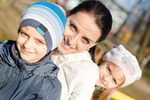 Mother with two children — Stock Photo