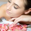 Brunette takes a relaxing spa treatments — Stock Photo #44786843