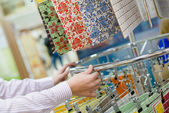 Employee presenting colorful tiles — Stock Photo