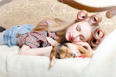 Blonde sleeping with her dog — Stock Photo