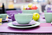 Cute green and purple dinnerware sold in the supermarket — Stock Photo