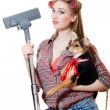 Picture of holding cute puppy and vacuum cleaner beautiful pinup blond young woman with blue eyes, curlers and red lips having fun posing happy smiling and looking at camera portrait — Stock Photo #49370233