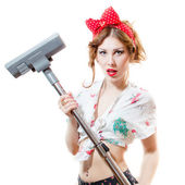Beautiful young blond pinup woman holding vacuum cleaner looking in camera isolated on white background portrait — Stock Photo