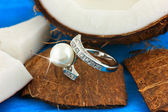 Ring with pearl on coconut — Stock Photo