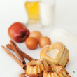 Stock Photo: Heart-shaped cake and ingredients for baking