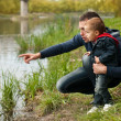 Stock Photo: Father and son at river