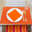 Tableclothes at a teak table in the garden — Stock Photo