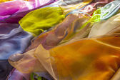 Colorful shawls at the market — Stock Photo