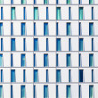 Stock Photo: Facade of skyscraper with windows structured in rows with differ