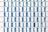 Facade of skyscraper with windows structured in rows with differ — Stock Photo