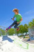 Boy jumps with his scooter at the skate park — Stock Photo