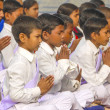 Stock Photo: young children pray in tibetan buddhist monastery sarnath