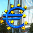 Euro Symbol in Frankfurt by night - Stock Photo