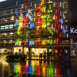 Stock Photo: BERLIN - APRIL 4: The famous shopping street Kurfuerstendamm with KADEWE in neon lights on April 4, 2012 in Berlin, Germany. The Kurfurstendamm, is one of the most popular German shopping streets.