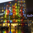 BERLIN - APRIL 4: The famous shopping street Kurfuerstendamm with KADEWE in neon lights on April 4, 2012 in Berlin, Germany. The Kurfurstendamm, is one of the most popular German shopping streets. — Stock Photo