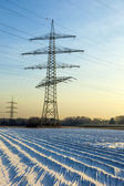 Electrical tower in rural landscape with fields in foil — Stock Photo