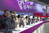Visitors test huge tele lenses at Photokina 2012. — Stock Photo