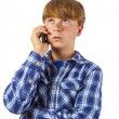 Cute handsome young boy speaking a mobile phone  — Stock Photo