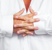 Detail of folded hands of a man — Stock Photo
