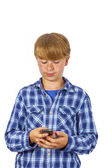Cute handsome young boy speaking with a mobile phone — Stock Photo