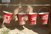 Red fire buckets filled with sand to protect in case of fire — Stock Photo