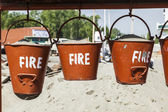 Bucket with sand in a petrol station for fire fighting — Stock Photo