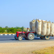 Straw transport with tractor on country road - Stock Photo