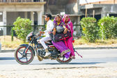 Man with Mother and wife riding on scooter on the highway — Stock Photo