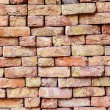 Stapled bricks give harmonic pattern in red — Stock Photo #15699091