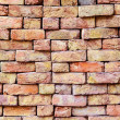 Stapled bricks give harmonic pattern in red — Stock Photo #15699777