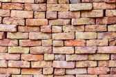 Stapled bricks give a harmonic pattern in red — Stock Photo