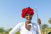A Rajasthani tribal man wearing traditional colorful turban and — Stock Photo