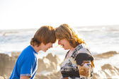 Mother and son enjoy the afternoon sun at the beach — Stock Photo