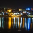 Reflection of the ghats in Pushkar in the lake by night — Stock Photo