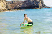 Boy waiting for the wave to surf — Stock Photo