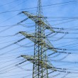 Tower for electricity in rural landscape - Stock Photo