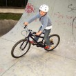 Child with bike in the half pipe - Stock Photo