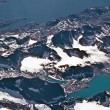 Stock Photo: Birds view from the plane to the glaciers and mountains of the a