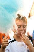 Child is eating cotton candy with fun — Stock Photo