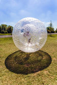 Child has fun in the Zorbing Ball — Stock Photo