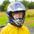 Happy boy with helmet at kart trail — Stock Photo #17418541