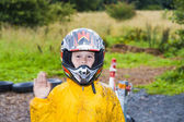 Happy boy with helmet at the kart trail — Stock Photo