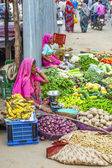 Vendors sell goods in a vegetable street market — Stock Photo