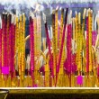Joss sticks near Giant Buddha - Stock Photo