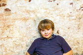 Boy in the cellar with a spotlight — Stock Photo